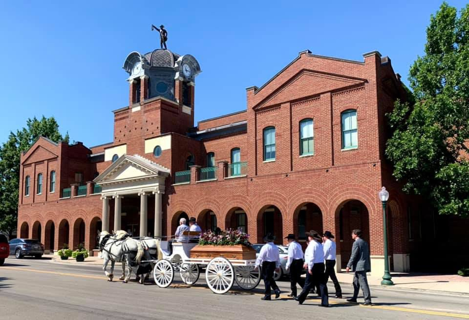 A horse-drawn hearse procession led to a reception featuring Gayle Hall's favorite Grapevine foods on Tuesday.
