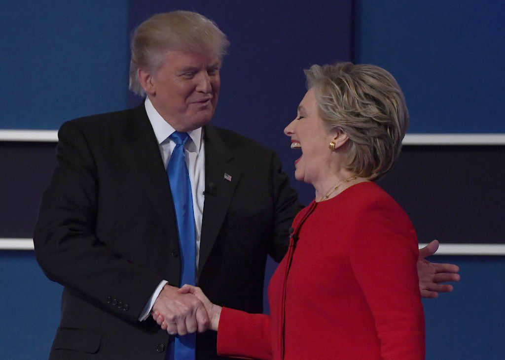 The candidates shook hands after their first debate.