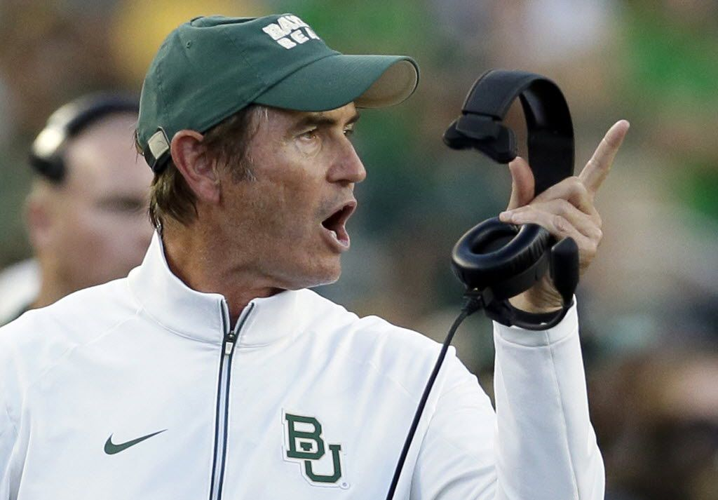 FILE - In this Sept. 12, 2015, file photo, Baylor coach Art Briles yells from the sideline during the first half of an NCAA college football game against Lamar in Waco, Texas. Briles is accusing Baylor of wrongful termination and indicating he has no interest in settling a federal lawsuit filed against him and the university by a woman who was raped by a football player, according to a motion filed Thursday, June 16, 2016, as part of the lawsuit. Briles says he wants a judge to assign him new attorneys and his personal legal team is demanding that Baylor turn over all its files in the sexual assault scandal that has gripped the Baptist university for months. (AP Photo/LM Otero, File)