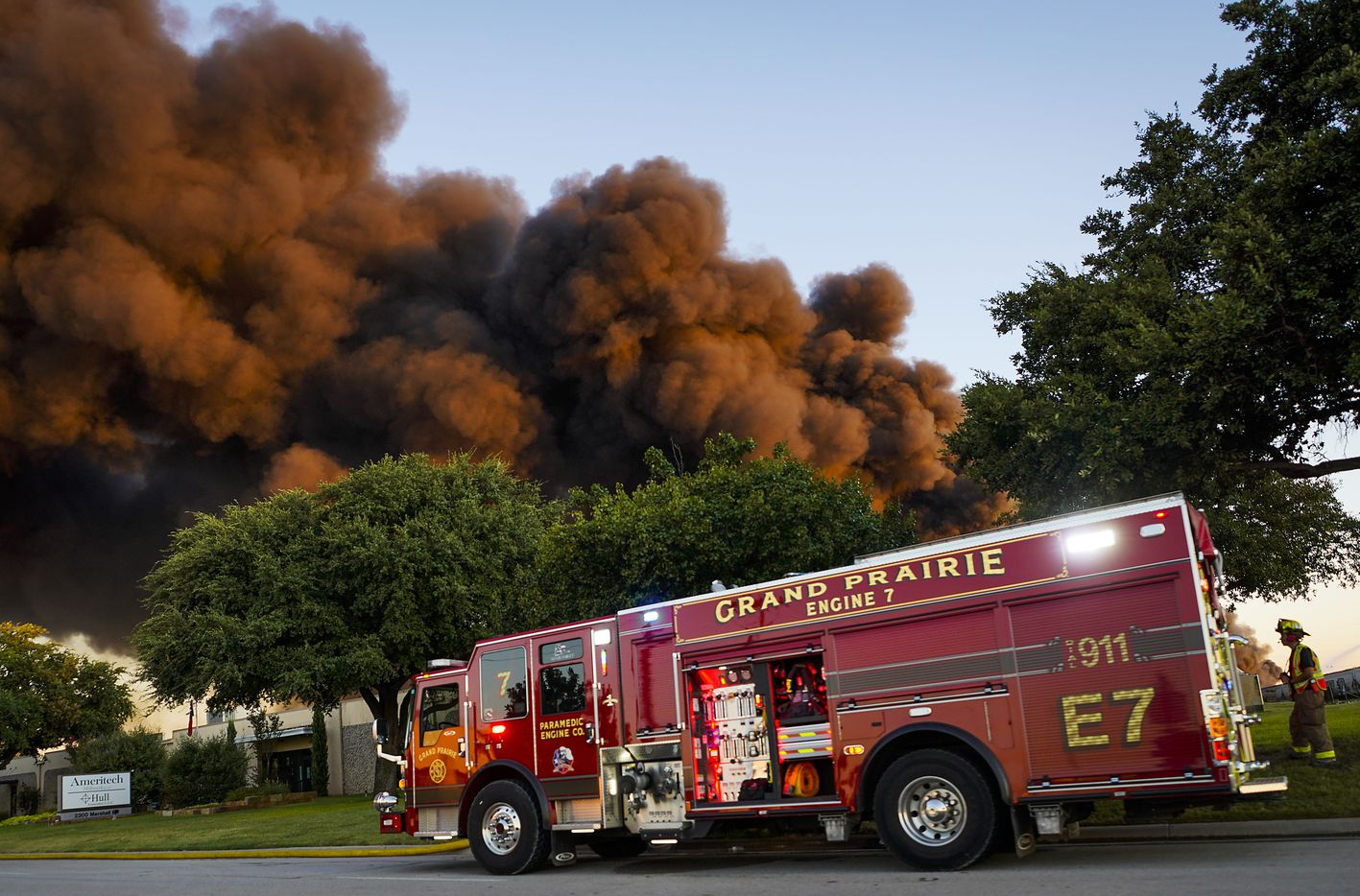 Fire crews battle a massive blaze in an industrial area of Grand Prairie just before sunrise on Wednesday, Aug. 19, 2020.