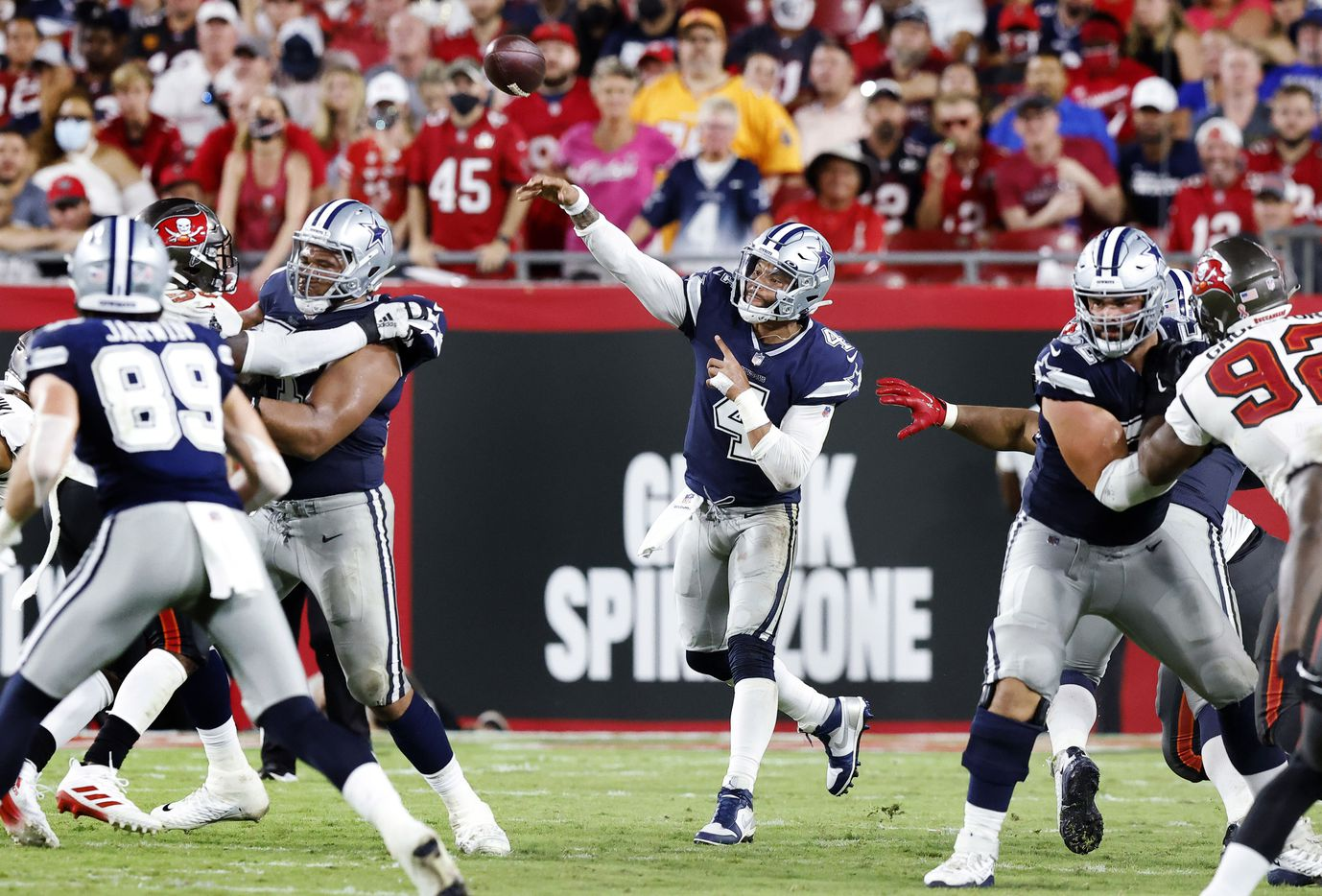 Dallas Cowboys quarterback Dak Prescott (4) throws a deep third quarter pass to wide receiver CeeDee Lamb (88), only to have it intercepted at Raymond James Stadium in Tampa, Florida, Thursday, September 9, 2021. The Cowboys faced the Tampa Bay Buccaneers in the NFL season opener. (Tom Fox/The Dallas Morning News)