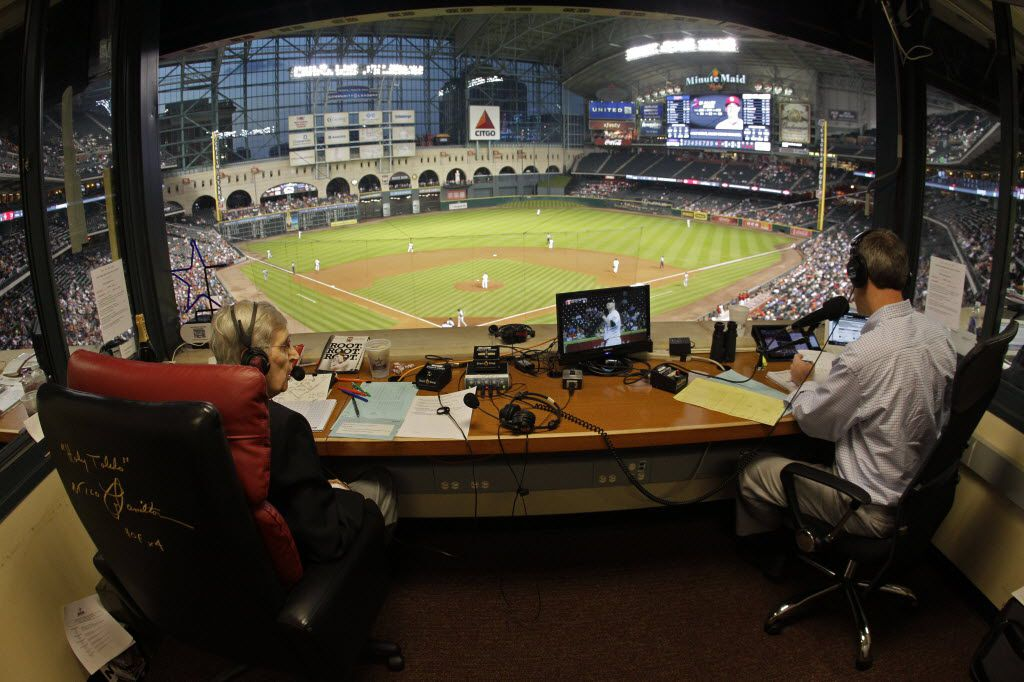 Milo Hamilton, left, and Dave Raymond, right, in the radio booth as Milo calls the Houston Astros and St. Louis Cardinals game that will his last home game as the radio voice of the Astros. (Melissa Phillip/The Houston Chronicle)