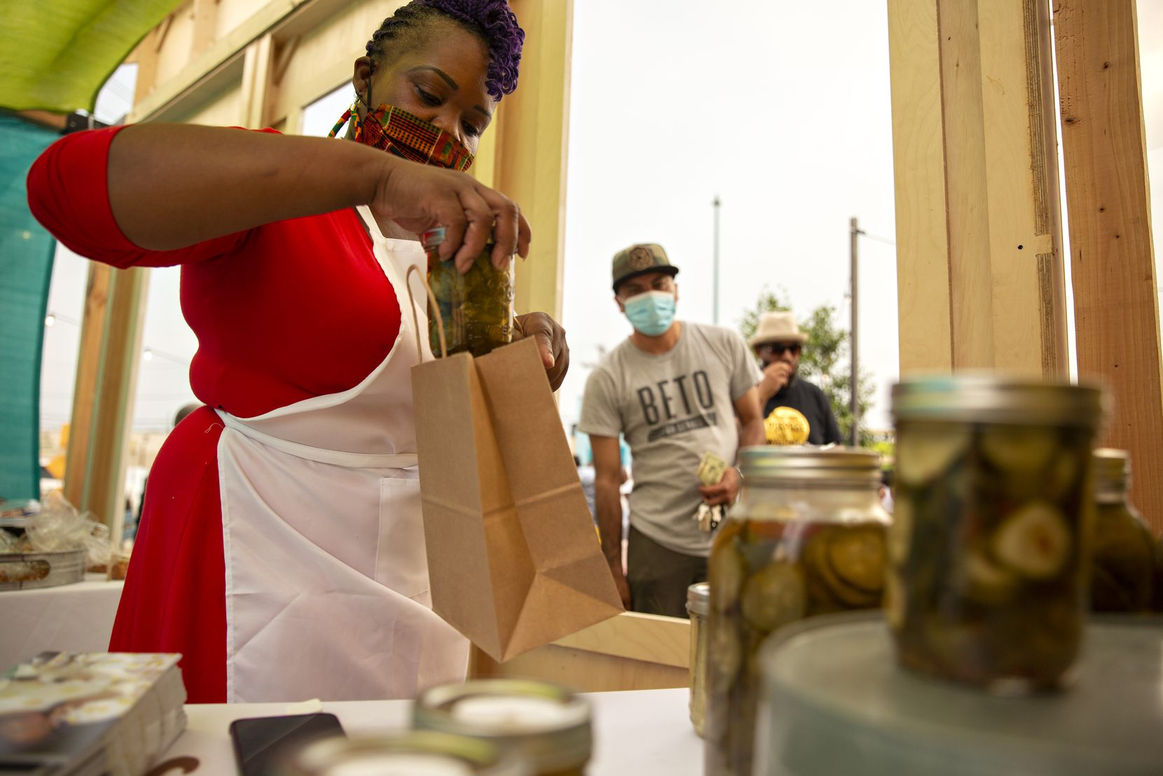 Shanay Wise of Catering Done Wisely packed just-purchased pickles at the launching of the MLK Food Park in Dallas on April 9, 2021.