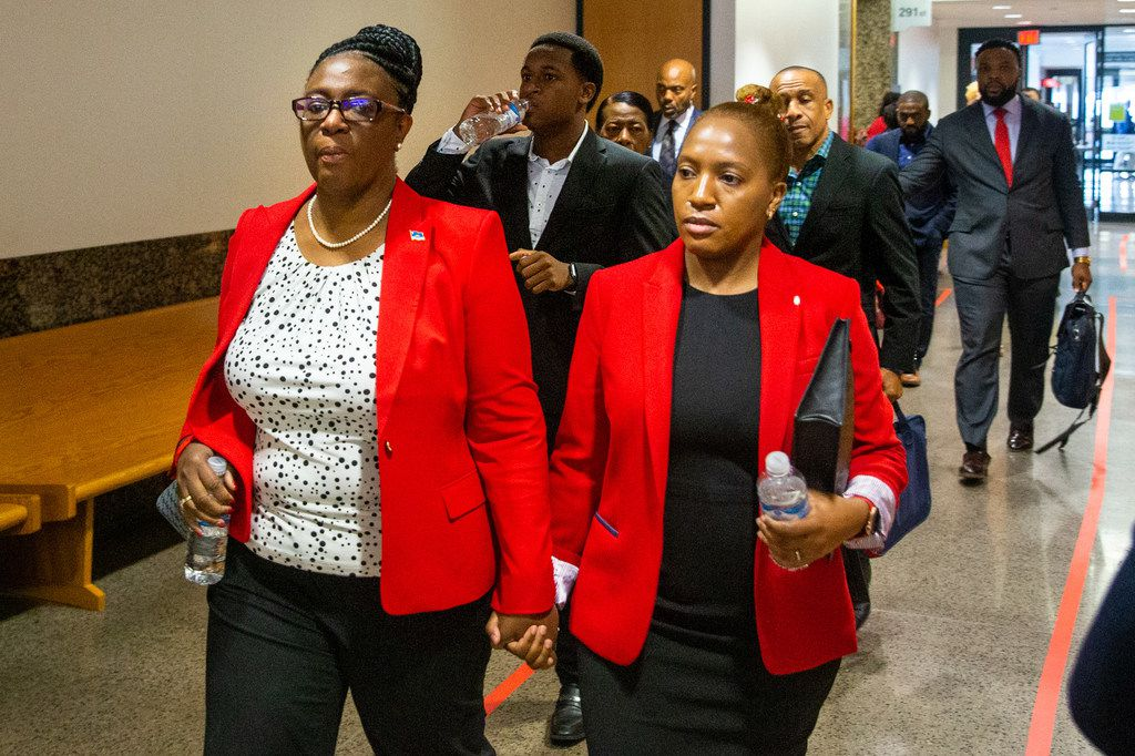 Allison Jean (left), mother of shooting victim Botham Jean, walks with her daughter Allisa Findley (right) and other family members as they arrive at the murder trial of Amber Guyger at the Frank Crowley Courts Building in Dallas on Monday morning, Sep. 23, 2019.