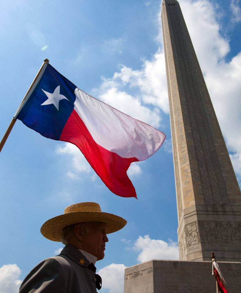 A flag flies over Col. John Martin of the Texas Army during ceremonies commemorating the 174th Anniversary of the Battle of San Jacinto at the San Jacinto Monument in La Porte on April 21, 2010. The group is the state's Official 1836 Ceremonial and Reenactment Group.