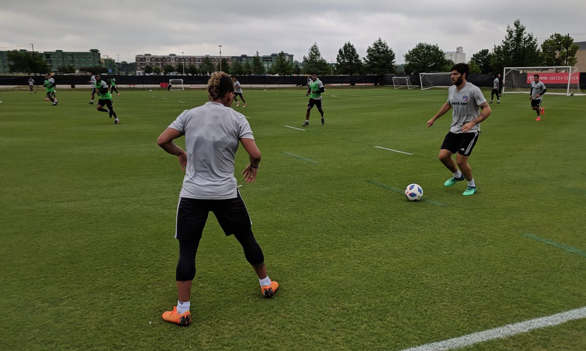 Ryan Hollingshead and Michael Barrios work the ball up the left wing in training. (5-2-18)