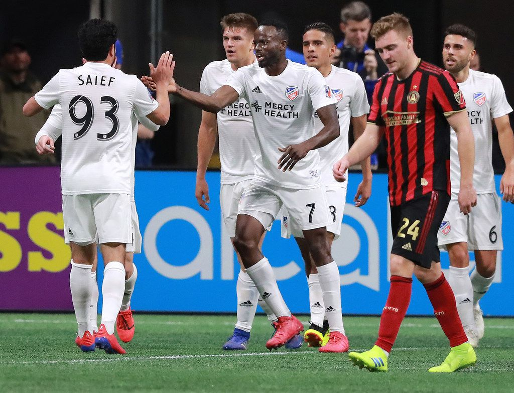 Atlanta United defender Julian Gressel walks away dejected as FC Cincinnati midfielder Roland Lamah (center) celebrates his goal with teammate Kenny Saief on Sunday, March 10, 2019, in Atlanta, Ga. The teams played to a 1-1 draw. (Curtis Compton/Atlanta Journal-Constitution/TNS)