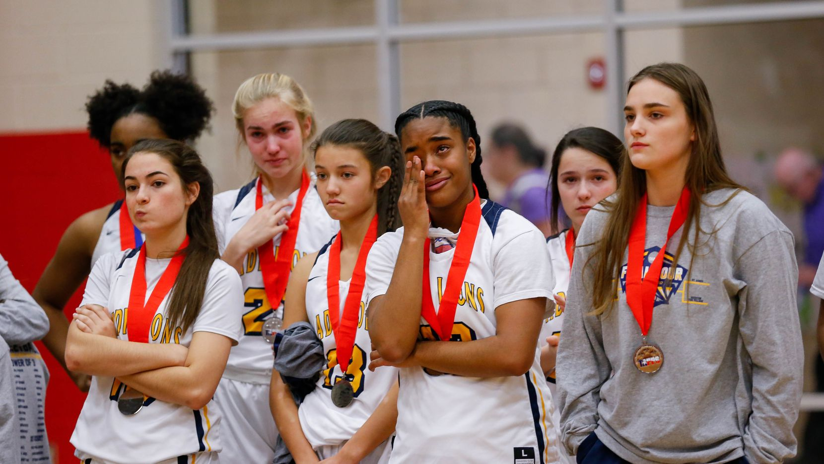 Plano Prestonwood Christian players react after losing a TAPPS Class 6A girls basketball state championship game against the Village School on Feb. 28, 2020 in West. Prestonwood lost 75-48.