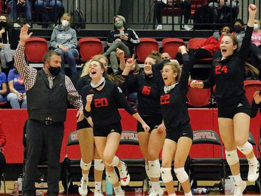 Lovejoy High School head coach Ryan Mitchell reacts with the bench as they sweep the match at the end of game three as Grapevine High School played Lovejoy High School at Coppell High School in a Class 5A state semifinal match in Coppell on Monday, December 7, 2020.