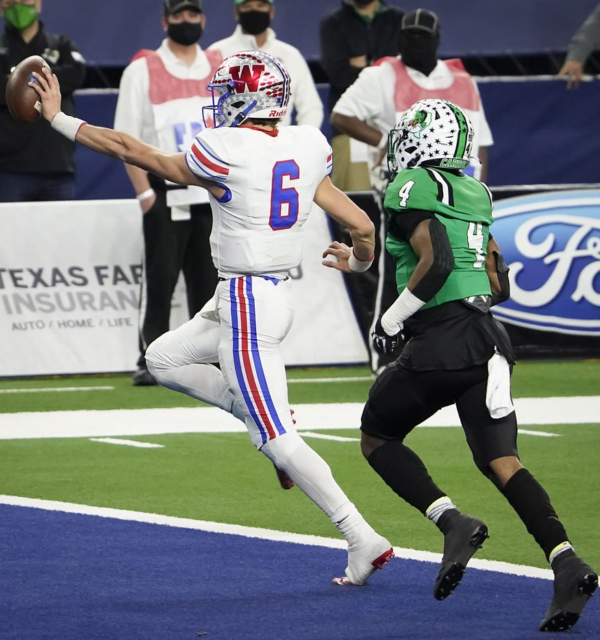 Austin Westlake quarterback Cade Klubnik (6) scores on a 1-yard touchdown run past Southlake Carroll defensive back Cinque Williams (4) during the second quarter of the Class 6A Division I state football championship game at AT&T Stadium on Saturday, Jan. 16, 2021, in Arlington, Texas.