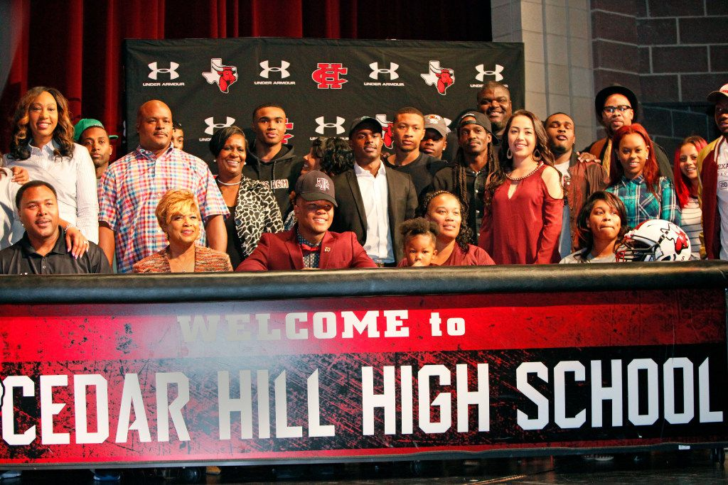 Cedar Hill wide receiver Camron Buckley, wearing bowtie, sits with his friends and family including grandmother Ethel Buckley, left of him, and mother Andria Williams, right, during the school's National Signing Day ceremony, Wednesday, Feb. 01, 2017 at Cedar Hill High School in Cedar Hill. Buckley signed to play football with Texas A&M University. Ben Torres/Special Contributor