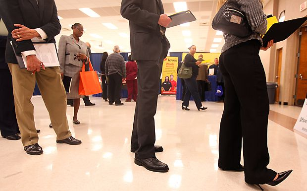 Job seekers wait to have their résumés critiqued by a professional during a Career Expo at the Richardson Civic Center in 2019.