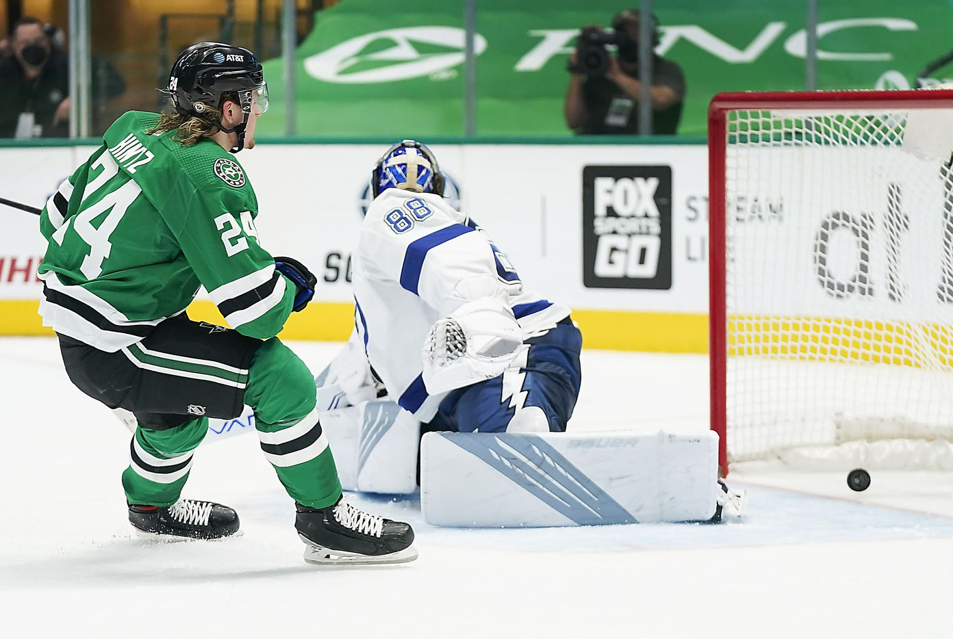 Dallas Stars left wing Roope Hintz (24) puts the puck past Tampa Bay Lightning goaltender Andrei Vasilevskiy (88) to score the game-winning goal at 18:39 of the third period of an NHL hockey game at the American Airlines Center on Thursday, March 25, 2021, in Dallas. The Stars won the game 4-3. (Smiley N. Pool/The Dallas Morning News)