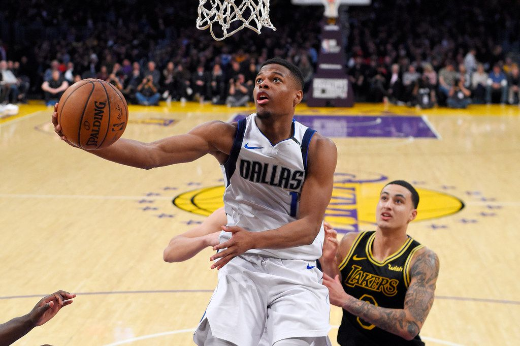 Dallas Mavericks guard Dennis Smith Jr., left, shoots as Los Angeles Lakers forward Kyle Kuzma defends during the second half of an NBA basketball game, Friday, Feb. 23, 2018, in Los Angeles. The Lakers won 124-102. (AP Photo/Mark J. Terrill)