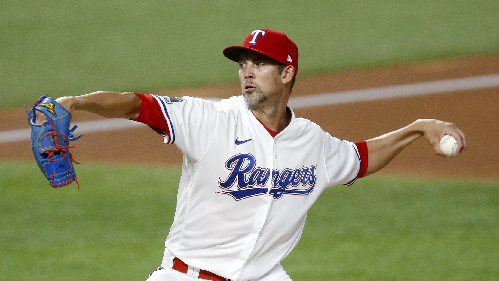 Texas Rangers starting pitcher Mike Minor (23) throws in the first inning against the Seattle Mariners at Globe Life Field in Arlington, Tuesday, August 11, 2020.
