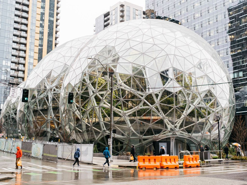 The glass spheres outside Amazon's headquarters in Seattle, Jan. 24, 2018. Amazon abruptly escalated a fight with its hometown on May 2, halting major expansion plans in Seattle because of a tax under consideration that would charge large employers in the city about $500 per employee. (Kyle Johnson/The New York Times)