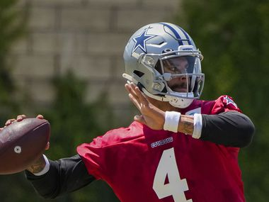 Dallas Cowboys quarterback Dak Prescott throws a pass while works with wide receiver Amari Cooper to the side of a practice at training camp on Tuesday, Aug. 10, 2021, in Oxnard, Calif.