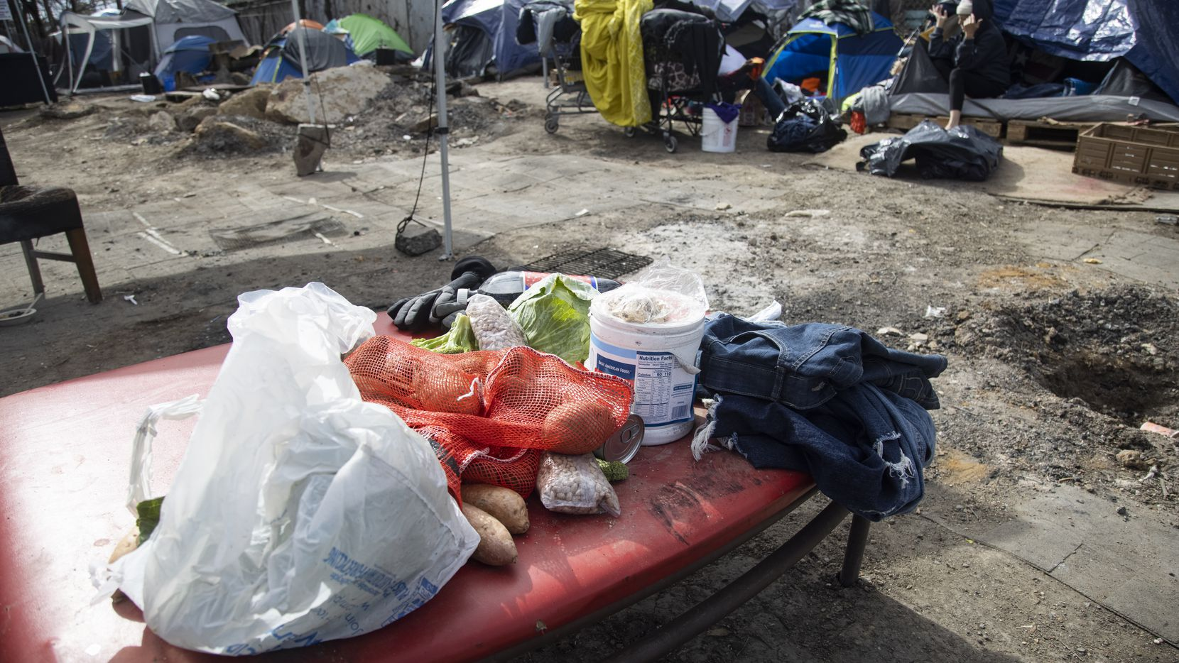 Food at Camp Rhonda, a homeless encampment located on a lot along Interstate 45, on Feb. 5, 2021 in South Dallas. Last week, city officials sent a notice to the owner of the property, Johnny Aguinaga, stating that the lot needed to be empty by Feb. 6.