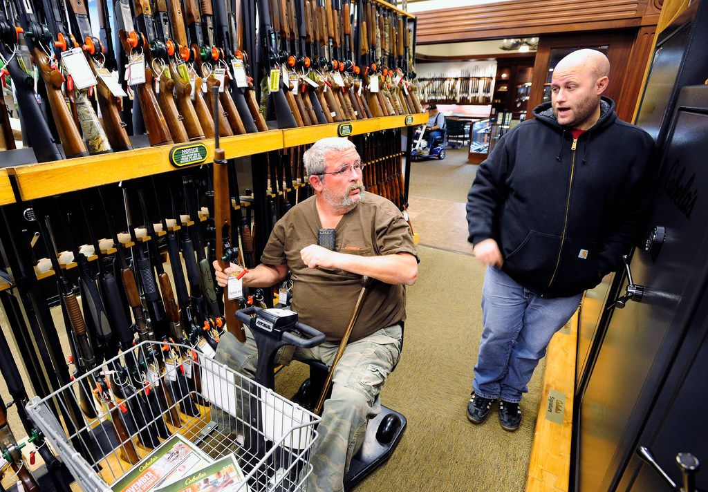 In this Nov. 10, 2014, file photo, Jerry Lyons, left, talks with Pat Ison at the Cabela's store in Dundee, Mich.