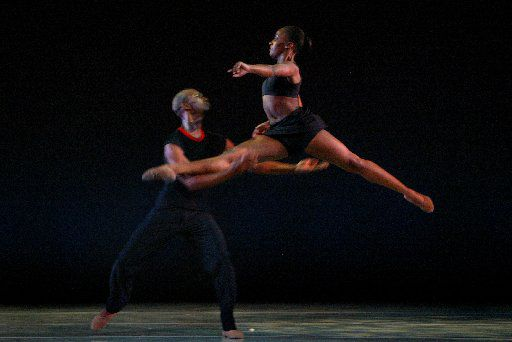 Kevin Jackson catches Alicia Pegues as Dallas Black Dance Theatre performs in the 2007 premiere of Ray Mercer's Pulse.