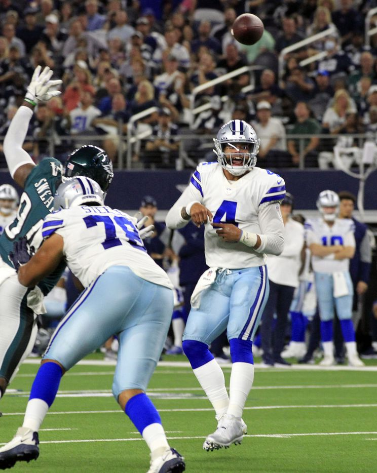 Dallas Cowboys quarterback Dak Prescott (4) looks surprised as he watches his pass during the first half of a NFL football game against the Philadelphia Eagles High at AT&T Stadium in Arlington on Monday, September 27, 2021. (John F. Rhodes / Special Contributor)
