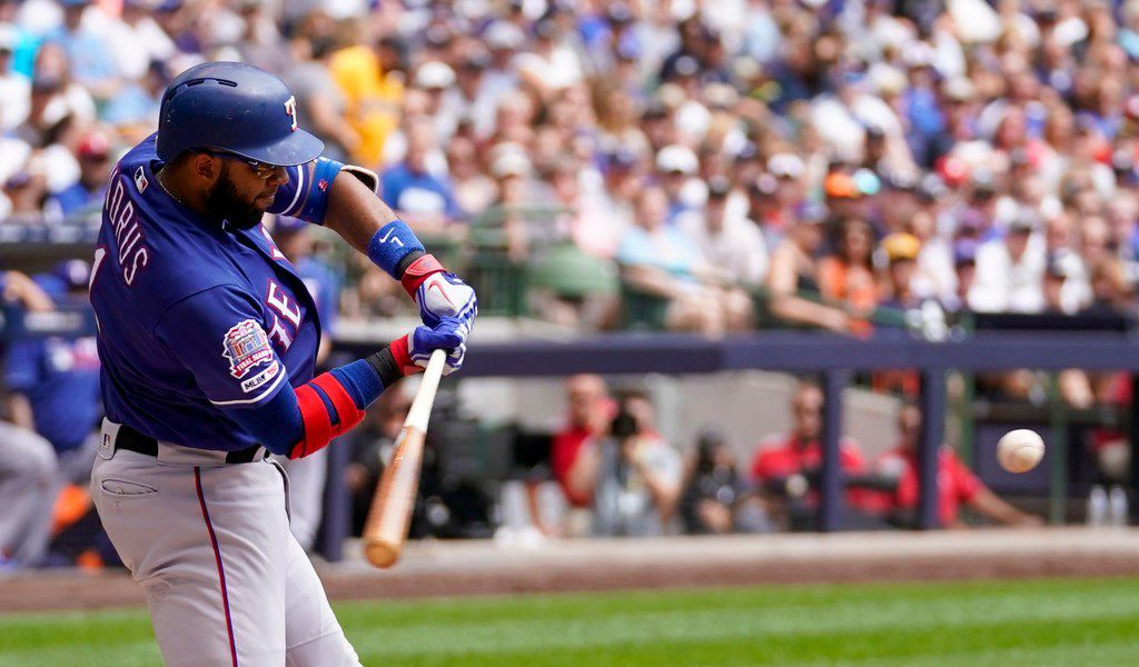 Texas Rangers' Elvis Andrus his a single during the first inning of a baseball game against the Milwaukee Brewers Sunday, Aug. 11, 2019, in Milwaukee. (AP Photo/Morry Gash)
