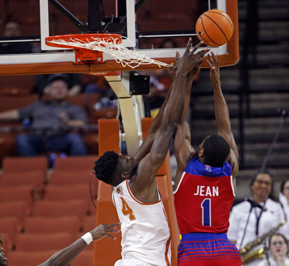Texas center Mohamed Bamba (4) goes up for the rebound against Louisiana Texas guard Derrick Jean (1) during the first half of an NCAA college basketball game, Saturday, Dec. 16, 2017, in Austin, Texas. (AP Photo/Michael Thomas)