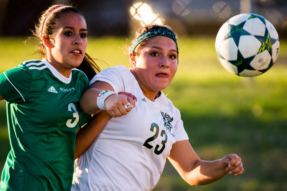 Prosper forward Gabby Gamboa (23) fights for the ball against Mesquite Poteet defender Marisol Jaimes (3) during the first half of a girls Class 5A area-round playoff soccer game.