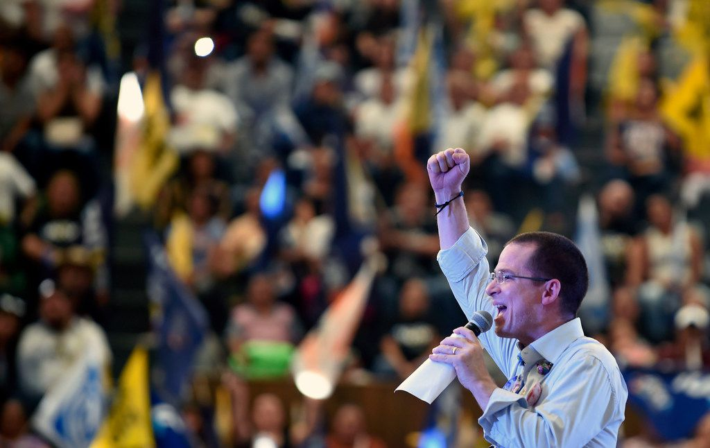 """Mexico's presidential candidate Ricardo Anaya (C), standing for the """"Por Mexico al Frente"""" coalition of the PAN-PRD parties, speaks to supporters during a campaign rally at the Palacio del Arte in Morelia, Michoacan State, Mexico, on May 26, 2018."""