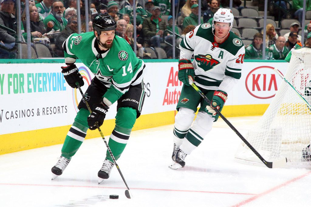 Dallas Stars left wing Jamie Benn (14) is pursued by Minnesota Wild defenseman Ryan Suter (20) in the first period during an NHL hockey game Friday, Feb. 7, 2020 in Dallas.