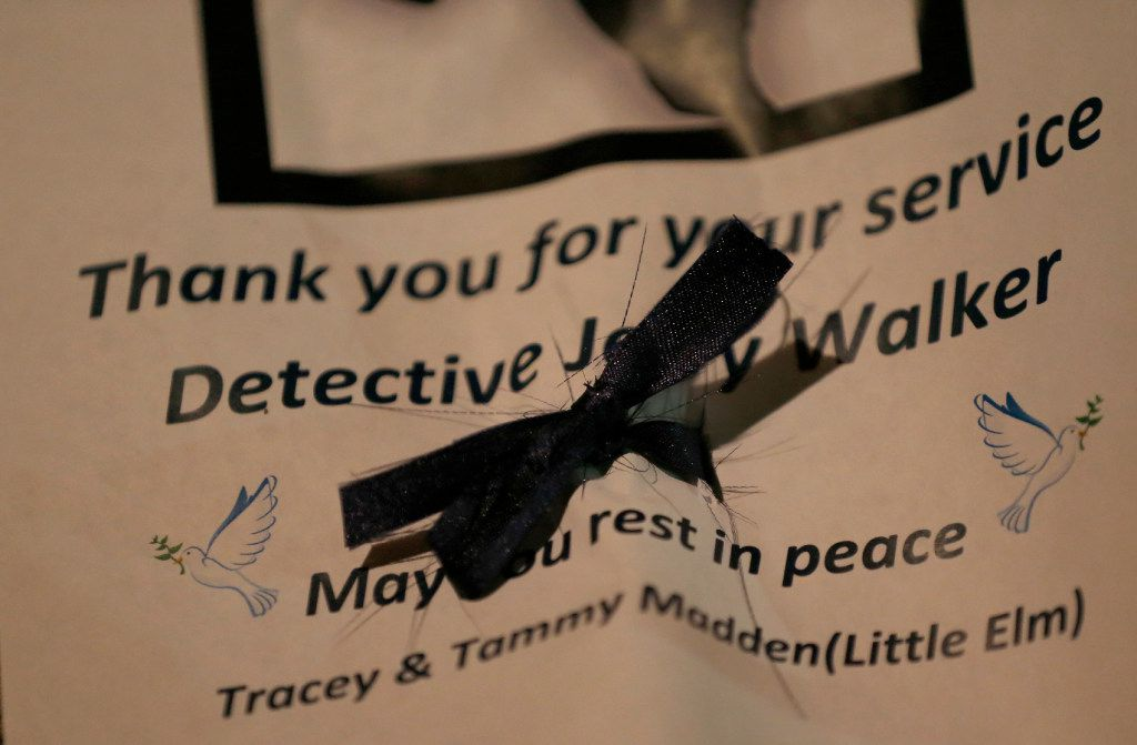 A note with a black ribbon is seen during a vigil for Det. Jerry Walker at Little Elm Park in Little Elm, Texas, Wednesday, Jan. 18, 2017. Det. Jerry Walker died at the Denton Regional Medical Center after he was shot in a standoff with a gunman yesterday. (Jae S. Lee/The Dallas Morning News)