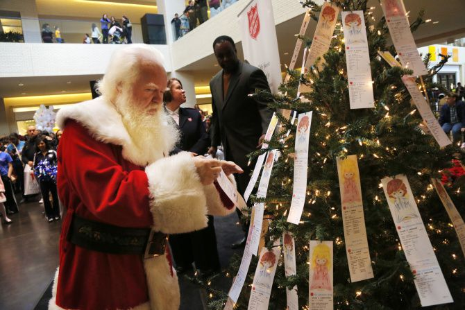 """In this file image, Santa selected an """"angel"""" from the Salvation Army's Angel Tree at NorthPark Center after a kickoff parade on Black Friday."""
