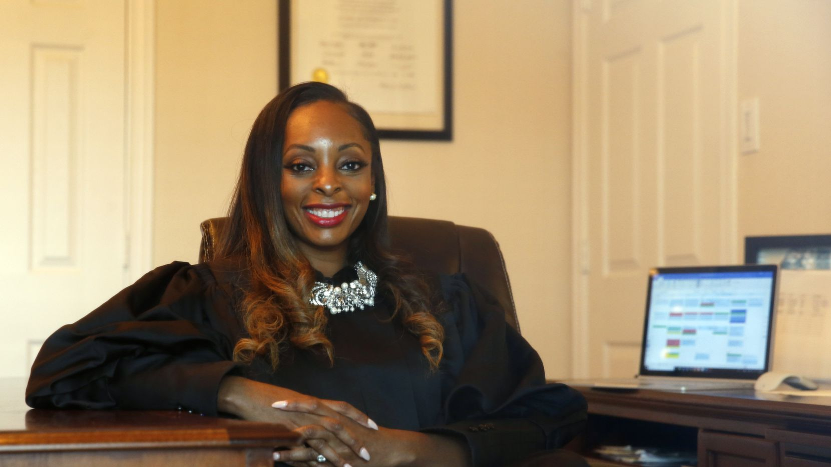 Judge Shequitta Kelly, a misdemeanor court judge poses for a portrait where she works from home amid the coronavirus pandemic, on Thursday, April 9, 2020.