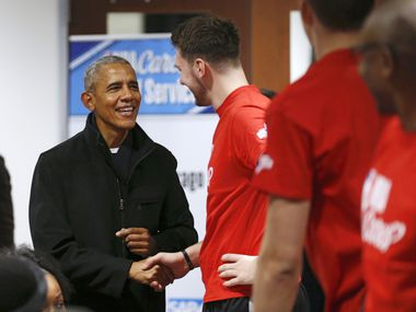 Former President Barack Obama greets Dallas Mavericks forward Luka Doncic (77) during a NBA Cares Day of Service event during NBA All Star 2020 at Wintrust Arena in Chicago on Friday, February 14, 2020.