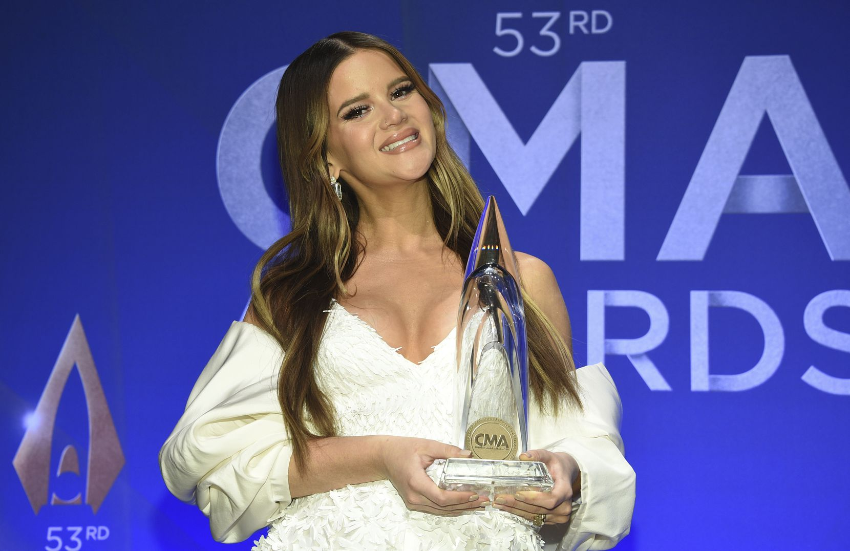 Singer-songwriter Maren Morris poses in the press room with the album of the year award at the 53rd annual CMA Awards at Bridgestone Arena on Wednesday, Nov. 13, 2019, in Nashville, Tenn.