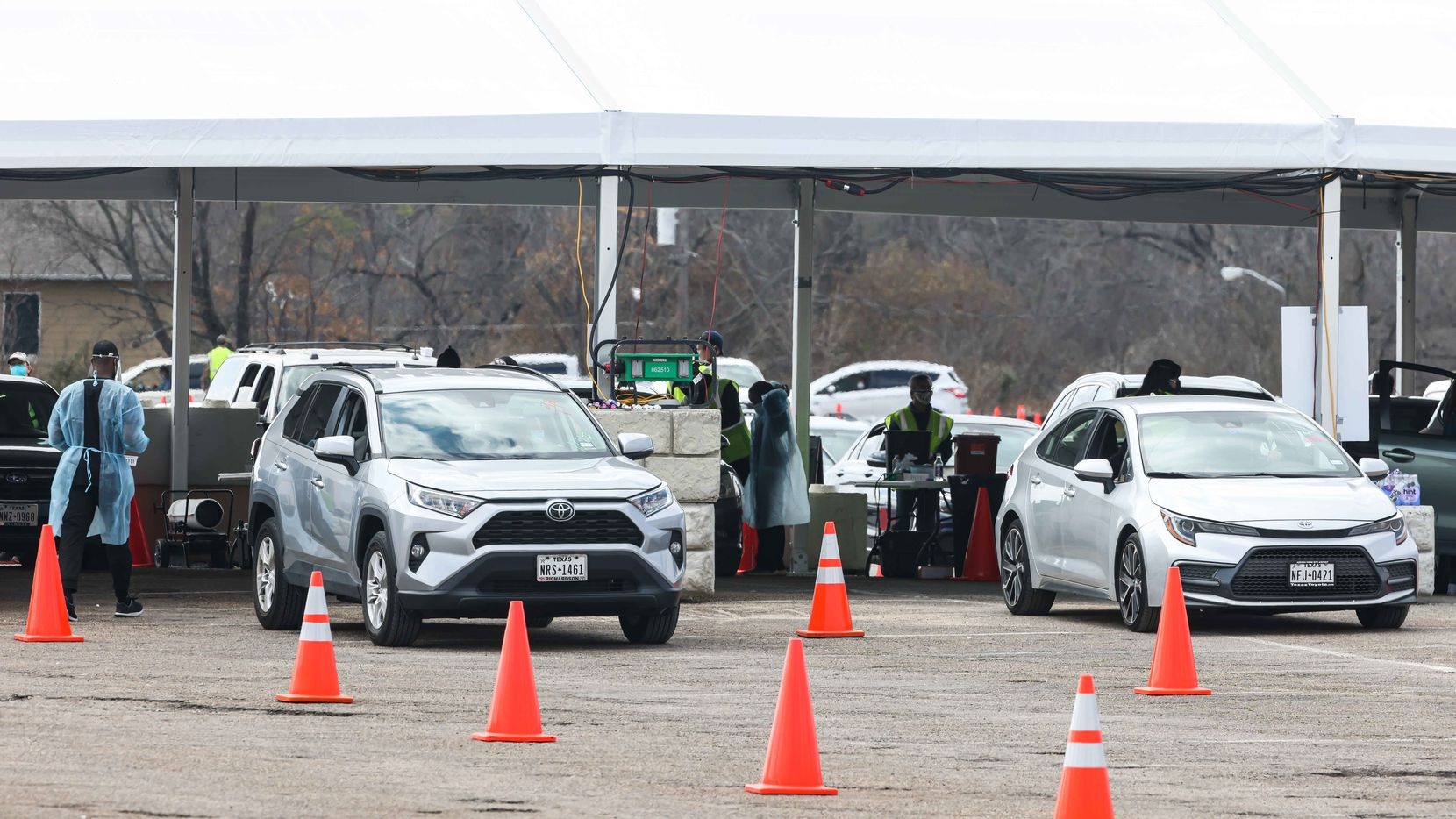 Dallas County, staff with support from FEMA and Army medics, administer doses of Pfizer, Moderna and Johnson & Johnson COVID-19 vaccines to patients by appointment at Fair Park in Dallas on March 5, 2021.