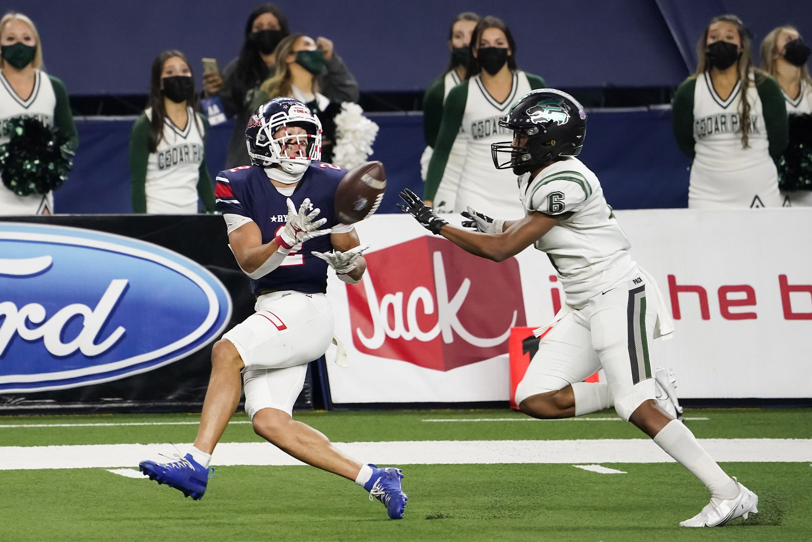 Denton Ryan Billy Bowman Jr. (2) hauls in a 37-yard touchdown pass from quarterback Seth Henigan as Cedar Park defensive back Michael Putney (6) defends during the first half of the Class 5A Division I state football championship game at AT&T Stadium on Friday, Jan. 15, 2021, in Arlington, Texas. (Smiley N. Pool/The Dallas Morning News)