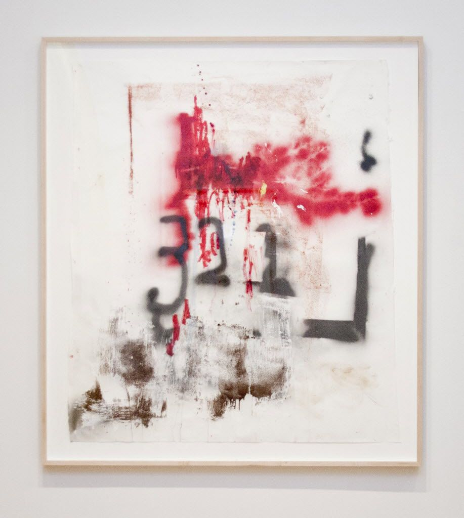 Stephen Lapthisophon is among the past winners of the Moss/Chumley award at Southern Methodist University. This piece of his is titled Red, 2013, Spray paint, oil stick, ink, pigmented bacon fat and pencil on paper Overall: 59 x 50 in.