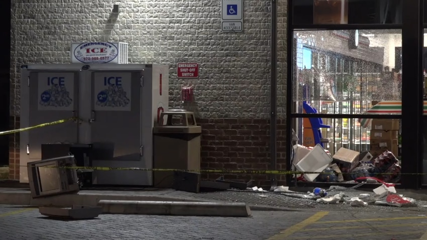 An image from the scene where five masked thieves rammed a pickup into a 7-Eleven and yanked an ATM from the building, from footage captured by Metro Video Dallas/Fort Worth.