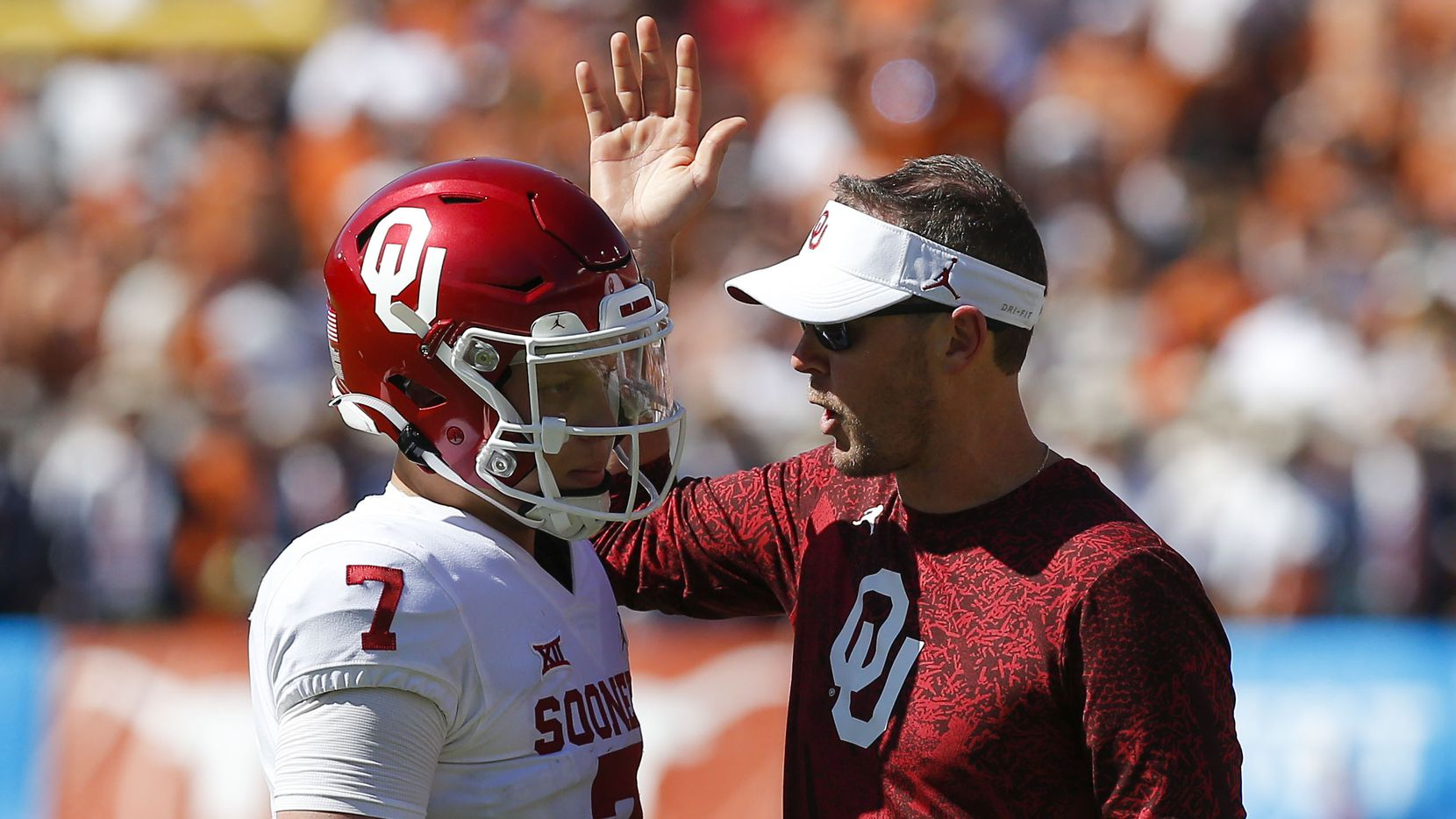 Oklahoma head coach Lincoln Riley reviews a play with Oklahoma quarterback Spencer Rattler (7) during the second half of an NCAA college football game against Texas at the Cotton Bowl in Fair Park, Saturday, October 9, 2021.