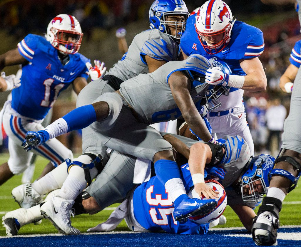 SMU Mustangs defenders keep Memphis Tigers running back Patrick Taylor Jr. (6) in the end zone for a safety during the second quarter of a college football game between SMU and Memphis on Friday, November 16, 2018 at Ford Stadium in Dallas. (Ashley Landis/The Dallas Morning News)