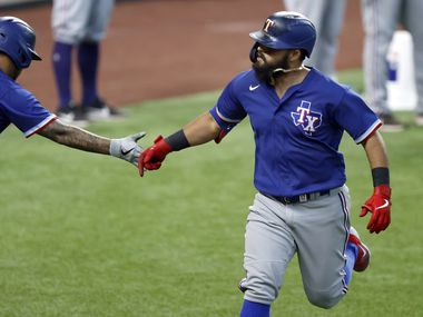 Texas Rangers Rougned Odor (right) is congratulated by teammate Willie Calhoun following his home run during a simulated Summer Camp game at Globe Life Field in Arlington, Texas, Thursday, July 9, 2020.