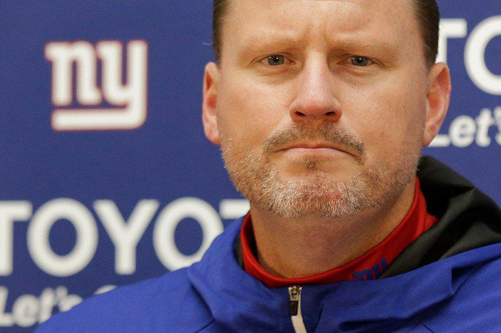 FILE - In this Nov. 24, 2017, file photo, New York Giants head coach Ben McAdoo listens to a question during a press conference after an NFL football game against the Washington Redskins in Landover, Md. A person familiar with the situation says Ben McAdoo has been fired as coach of the New York Giants and Jerry Reese is out as general manager less than a year after taking the team to the playoffs for the first time since 2011. McAdoo and Reese were fired Monday, Dec. 4, 2017, a day after the Giants were beaten in Oakland and dropped to 2-10, according to the person who spoke on condition of anonymity because the team had not made an official announcement. (AP Photo/Mark Tenally, File)