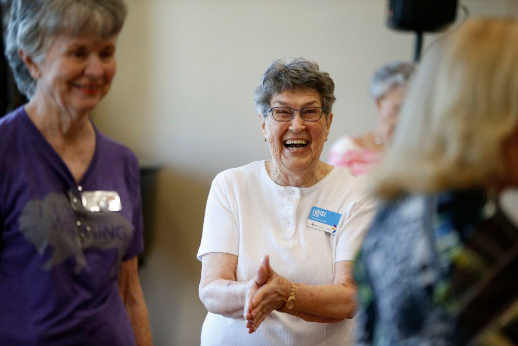 Louise Pierson claps during a line dancing class for seniors at Atria Canyon Creek in Plano.