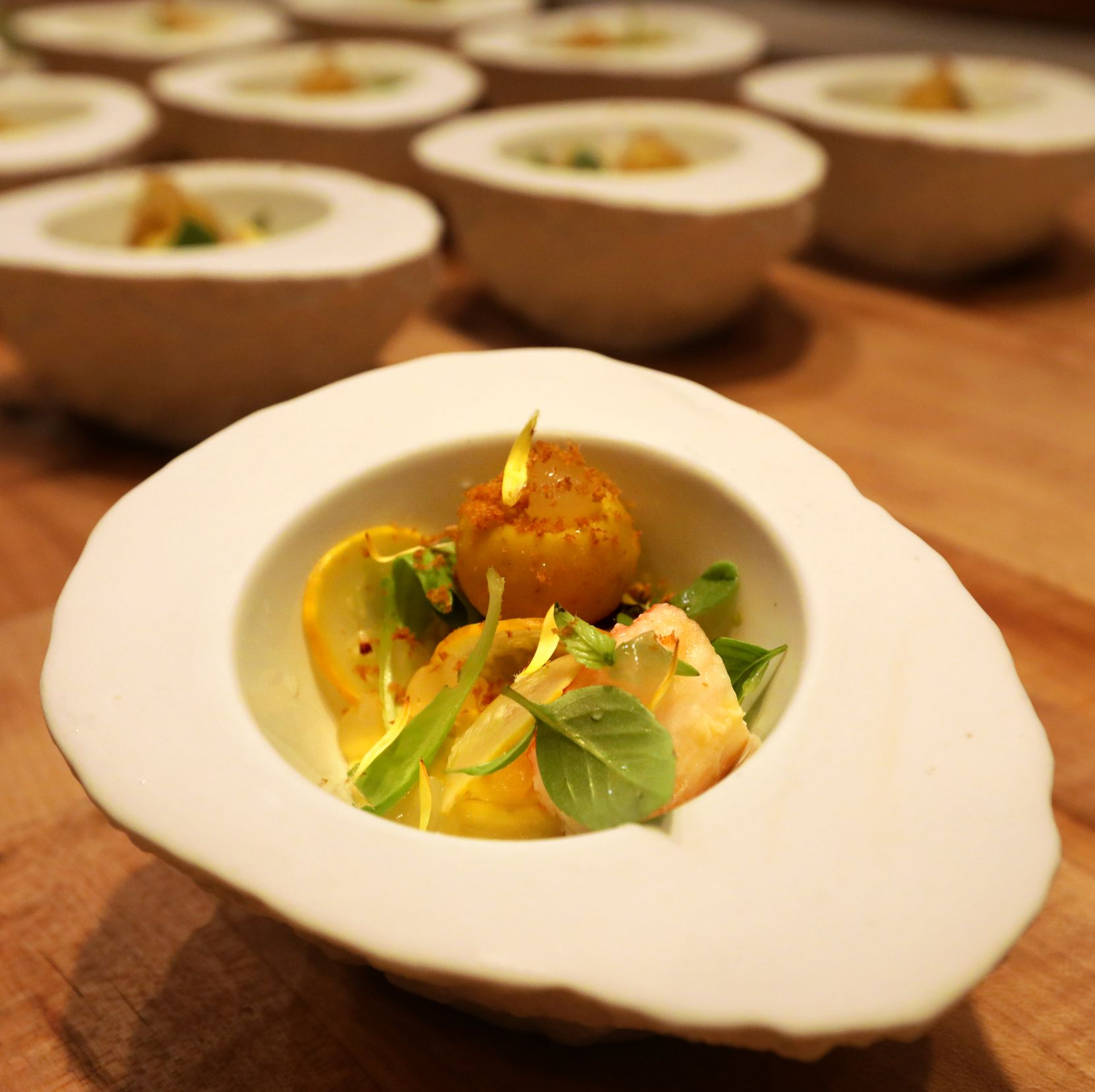 King Crab with a sphere of liquid dashi, plankton oil, butternut squash and custard infused with aji amarillo