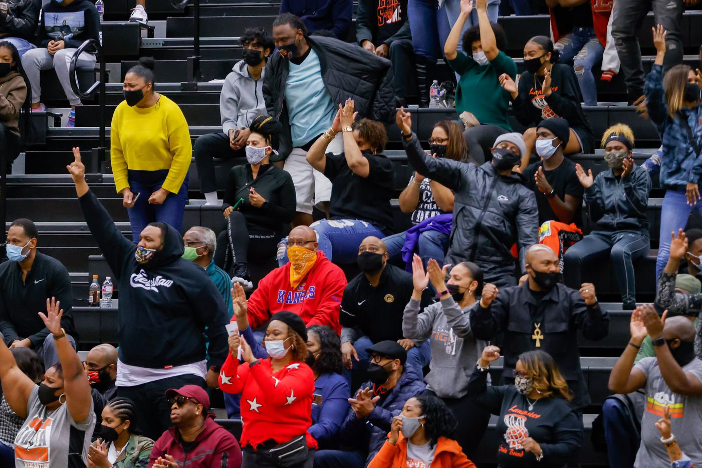 Lancaster fans celebrate during the first half of a boys basketball UIL Class 5A Region II playoff game against Kimball in Forney on Friday, March 5, 2021. (Juan Figueroa/ The Dallas Morning News)
