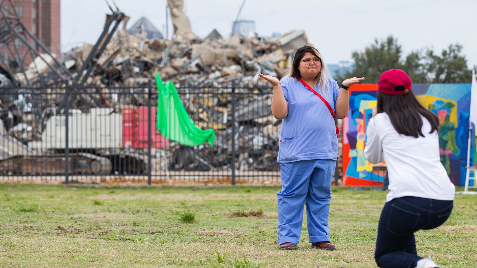 Jamila Alvarez takes a photo of Sarah Cruz in front of the remains of the Affiliated Computer Services building or the Leaning to Tower of Dallas at 2828 N. Haskell Avenue after finally falling over on Mar. 02, 2020 in Dallas. (Juan Figueroa/ The Dallas Morning News)