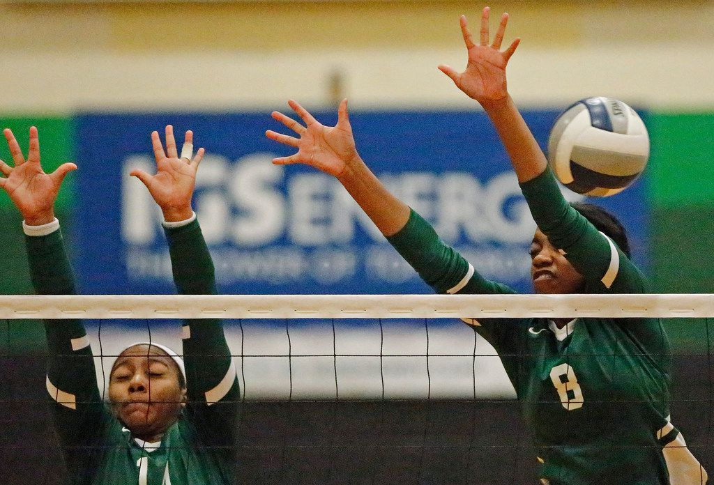 Lebanon Trail High School outside hitter Rayna Williams (14) and Lebanon Trail High School opposite Tyrah Ariail (8) attempt a block during game three as Lebanon Trail High School played Highland Park High School in a Class 5A Region II quarterfinal match played at Richardson Berkner High School on Monday night, November 12, 2019. (Stewart F. House/Special Contributor)
