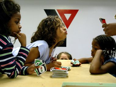 In this 2004 file photo, children play UNO during afterschool care at the Irving YMCA at 2200 West Irving Boulevard. The facility served many families in the South Irving area.