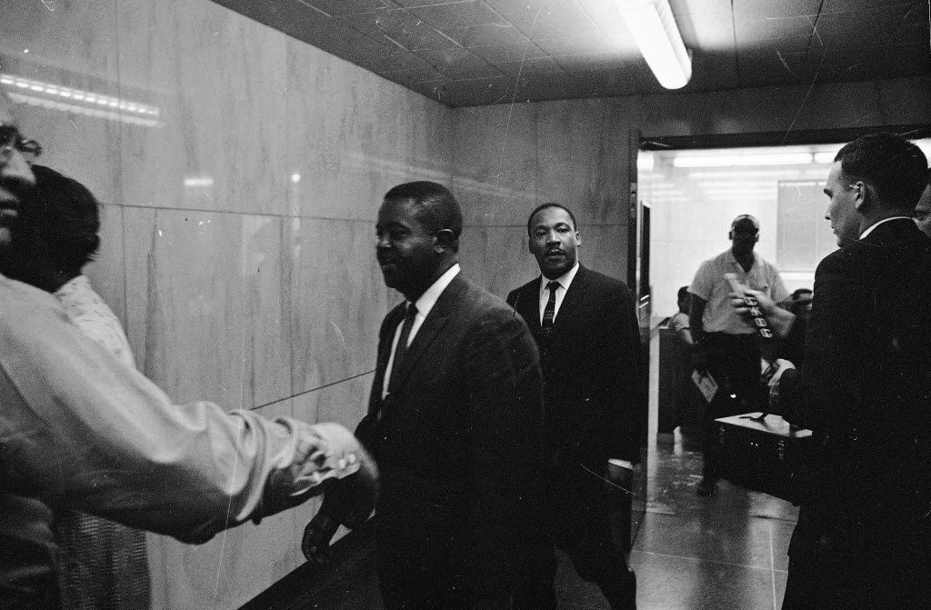 In this May 8, 1963 file photo, the Revs. Ralph Abernathy (left) and Martin Luther King Jr. walk through a corridor of the city jail in Birmingham, Ala., where they were held for several hours following conviction on charges of parading without a permit. They posted bond of $2,500.